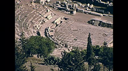 dionysus : Theatre of Dionysus aerial view from Acropolis hill with close up on theater ruins, from Athens in Greece. Restored historical 70s archival footage on 1972.