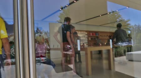 apple headquarter : Cupertino, California, USA - August 15, 2016: getting inside Apple store in One Infinite Loop road. first persion view. Stock Footage