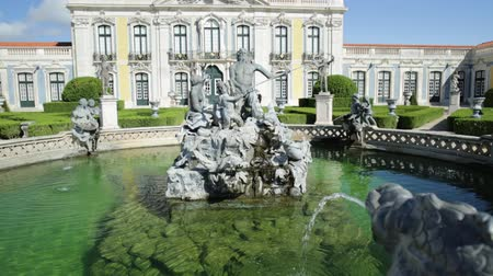 palacio real : Baroque facade of Queluz National Palace and Neptune Fountain in Sintra, Lisbon district. Defined as the Versailles of Portugal, the Royal Palace of Queluz was used as a fun place for the royal family