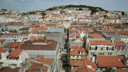 miradouro : Aerial view over Lisbon, Portugal, sunny day. Details of Monastery of Sao Vicente of Fora and Sao Jorge Castle from panoramic platform of Elevador de Santa Justa popular tourist attraction in Baixa. Stock Footage