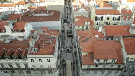 miradouro : Aerial view tilt of Lisbon downtown and Santa Justa Street to Sao Jorge Castle hill from panoramic platform of Elevador de Santa Justa or Miradouro de Santa Justa connecting Baixa to Igreja do Carmo. Stock Footage