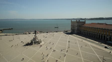 augusta : aerial view panorama from panoramic terrace of Rua Augusta Arch of King Dom Jose I equestrian statues and Tagus River, Praca do Comercio or Commerce Square in Baixa District in Lisbon, Portugal. Stock Footage