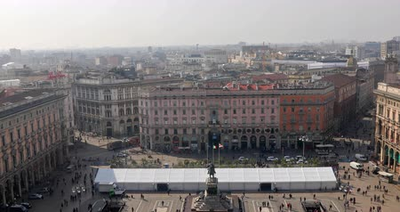galleria vittorio emanuele ii : MILAN, ITALY- MARCH 7, 2017: Aerial view panorama of Piazza Duomo di Milano square with tourists. Vittorio Emanuele II equestrian statue from Dome Cathedral top terrace.