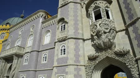 triton : Sculpture of a mythological triton that symbolizes the allegory of creation of the world. Detail on facade of Pena National Palace, Unesco Heritage in Sintra, Portugal.