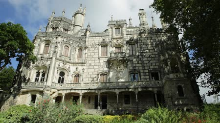 regaleira : Gothic facade of grand house and gardens of mysterious Regaleira Palace or Monteiro Palace, landmark and Unesco Heritage in Sintra historic center, Portugal. Sunny day, blue sky.