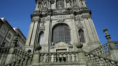 prospective : Prospective tilt view of baroque facade of Church of Clerigos or Igreja dos Clerigos in historic center of Porto, Porgugal, one famous panoramic viewpoint of city. Sunny day in the blue sky.