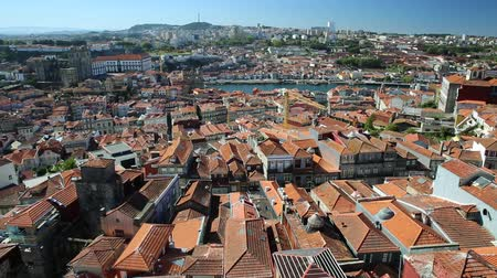portugese : Oporto urban landscape on Douro River and city skyline from Clerigos Tower, the highest point in the city of Porto. Cathedral or Se do Porto and Episcopal Palace or Paco Episcopal on background.
