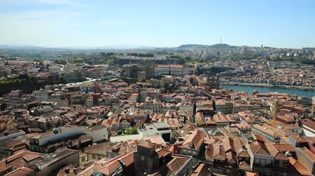 portugese : Panoramic views of historic center of Porto in Portugal from Clerigos Tower, one of the landmarks and icon of Oporto. Urban cityscape of intersection between rua da Carmelitas and rua dos Clerigos.