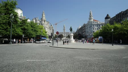 prospective : panoramic tour buses in Oporto, in Portugal, Praca da Liberdade or Freedom Square in Avenidas dos Alidaos in a sunny day of Portugal. Stock Footage