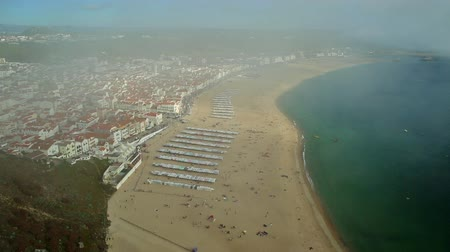 miradouro : Aerial view time lapse of skyline and beach wterfront from Miradouro do Suberco in Nazare Sitio, the upper part of the city above the giant cliffs in Central Portugal, Europe. Stock Footage