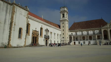 paco : Coimbra, Portugal - August 14, 2017:University of Coimbra, the most ancient of Portugal and also one of the oldest in Europe. Main Building in the Paco das Escolas and iconic University Clock Tower. Stock Footage