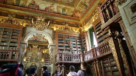 portugese : Coimbra, Portugal - August 14, 2017: University library in Coimbra, the Europes oldest university founded in 1290. Unesco World Heritage Site and most important tourist attraction in Upper Coimbra.