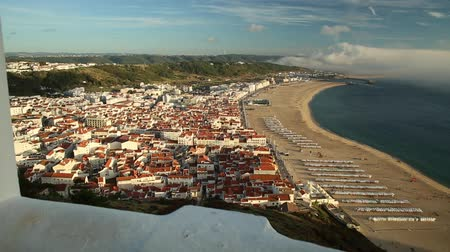 miradouro : POV admiring Nazare skyline and beach waterfront from Miradouro do Suberco in Nazare Sitio, Central Portugal, Europe. touristic aerial view. Freedom and travel concept