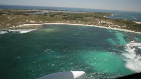 pinky : Aerial view of Rottnest Island in Australia, in a sunny day. Scenic flight over Salmon Bay and Wadjemup Lighthouse. Rottnest Island is located near Fremantle and Perth.