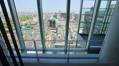 Osaka, Japan - April 30, 2017: elevator descending Abeno Harukas building, tallest skyscraper in Japan. On top of Kintetsu Osaka Abenobashi Station near JR Tennoji Station. Aerial Osaka cityscape.