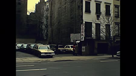 autó : New York, United States America - 1981: old Manhattan car park with old fees in dollars. Archival USA on 80s. Stock mozgókép