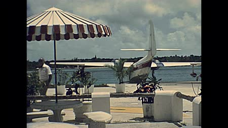 hydroplane : Nassau, Bahamas - Circa 1978: seaplane taking off from Nassau island in the sea. Historical Bahamas in 70s.
