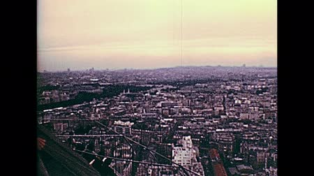 champ : PARIS, FRANCE - CIRCA 1976: Tourists in vintage 70s dress, looking the panorama of Paris from Eiffel Tower. Historic archival footage in Paris city of France in 1970s. Stock Footage