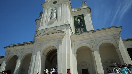 mary : Fatima, Portugal - August 15, 2017: tourists on stairway of Basilica of Nossa Senhora, Sanctuary of Fatima in Portugal, one of the most famous travel destinations for Catholic pilgrimage. Bottom view.