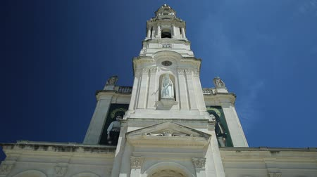 marian : Fatima, Portugal - August 15, 2017: Bell tower of Sanctuary of Our Lady of Fatima. Basilica of Nossa Senhora is one of most important shrines of the world dedicated to Virgin Mary and pilgrimage Site.