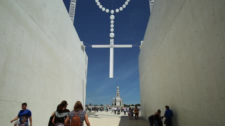 marian : Giant rosary in the blue sky at Sanctuary of Our Lady of Fatima, Portugal, one of the most important Marian Shrines and pilgrimage locations for Catholics. Stock Footage
