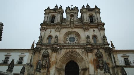 portugese : Bottom view of main gate of Roman Gothic Monastery of Alcobaca or Mosteiro de Santa Maria de Alcobaca, Unesco Heritage in Alcobaca. The church and convent were the first Gothic building in Portugal. Stock Footage