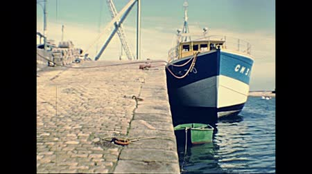 seventy : Camaret-sur-Mer, FRANCE - July 15, 1976: town pier with boats in Camaret sur Mer commune in the Crozon peninsula. Archival from 70s in France. UNESCO World Heritage Site. Stock Footage