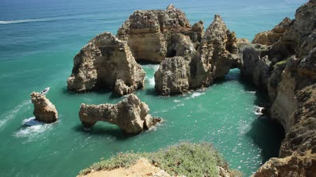ponta da piedade : Tourism in Algarve. POV looking at amazing views of Ponta da Piedade promontory. Enjoying iconic cliffs of Lagos. Summer holidays in Portugal, Europe. Stock Footage