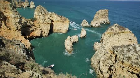 ponta da piedade : Summer holidays in Algarve, Portugal. Touristic boat trip in Ponta da Piedade and overlooks the coast of Lagos with iconic cliffs and limestone. Turquoise sea, sunny day.