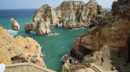 ponta da piedade : Lagos, Portugal - August 22, 2017:staircase that leads Ponta da Piedade. Pier for small boats for sightseeing between arches and natural caves. Tourists enjoying in Lagos, Algarve, Portugal.
