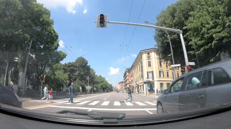 drive through : Bologna, Italy - May 19, 2018: POV driving to Bologna downtown city center along the historic Viale Massarenti avenue, passing by famous polyclinic hospital, Policlinico SantOrsola Malpighi.