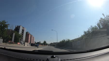 sprzedawca : Bologna, Italy - May 19, 2018: POV in hyper lapse of a car driving on Bologna city street of car dealers with famous brands as Kia, Fiat, Land Rover, Jaguar, Mazda, Mitsubishi, Suzuki, Hyundai.