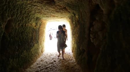 ponta da piedade : Lagos, Portugal - August 21, 2017:POV in tunnel view with people sunbathing on popular Praia do Camilo beach near Ponta da Piedade. Summer holidays in Algarve Coast, Portugal. Stock Footage