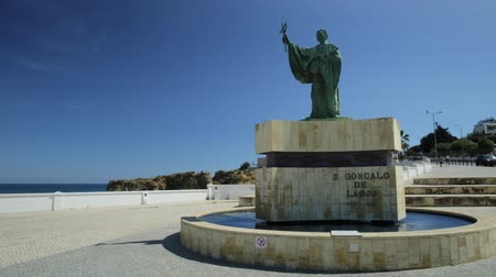 patron : Lagos, Portugal - August 19, 2017: statue of Sao Goncalo de Lagos, a Portuguese saint, revered above all by the Algarves fishermen for protection while at sea.Lagos near Batata Beach in Algarve Coast