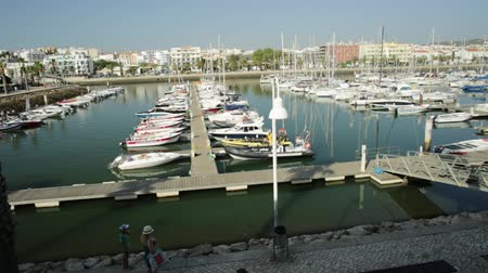 ancorado : Lagos, Portugal - August 19, 2017:Beautiful landscape of yachts, charters and motorboats in Marina de Lagos. The Marina is located in Bay of Lagos, Algarve coast, Portugal, Europe. Summer holidays.
