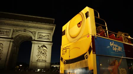 triumphal arch : Paris, France - July 2, 2017: touristic bus at Champs Elysees with Arc de Triomphe at night in Paris on background. Hop-On Hop-Off Tour, Paris. Explore top Paris attractions. Night urban scene.