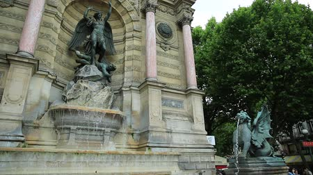 st michael the archangel : Paris, France - July 1, 2017: Fontaine Saint-Michel is one of the most monumental fountains in Place Saint-Michel. In front of fountain, two water-spouting dragons. Paris, France in europe.