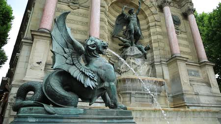 st michael the archangel : The Fontaine Saint-Michel is one of the most monumental fountains in the Place Saint-Michel. In front of the fountain, two water-spouting dragons. Perspective view. Paris, France in europe.