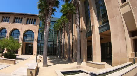 reseach : Palo Alto, California, United States - August 13, 2018: courtyard of Stanford Institute Economic Policy Research. Stanford University is one of the most prestigious universities in the world. Stock Footage