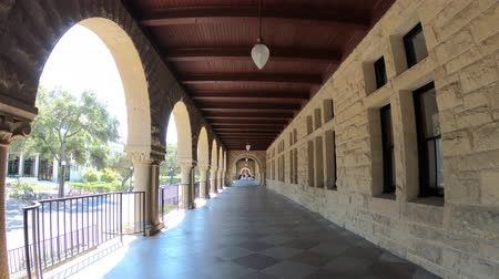 acadêmico : Palo Alto, California, United States - August 13, 2018: POV walking in the Pigott Hall archway of Stanford University of Silicon Valley, San Francisco Bay area.