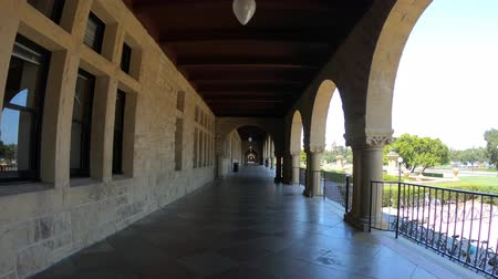 silicon : Palo Alto, California, United States - August 13, 2018: POV under the Pigott Hall archway of Stanford University of Silicon Valley. Stock Footage