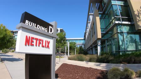blockbuster : Los Gatos, California, United States - August 12, 2018: Netflix Logo at Netflix Headquarters in Silicon Valley, Ca. Netflix is an entertainment service provider for movies and tv.