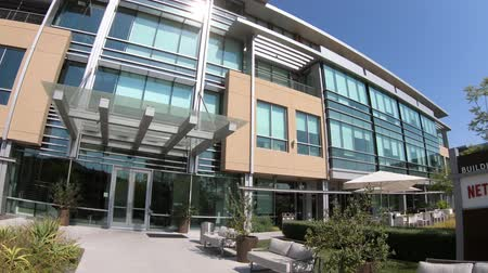 blockbuster : Los Gatos, California, United States - August 12, 2018: The new campus of Netflix HQ made of self-darkening intelligent glass for optimal lighting in Silicon Valley. Stock Footage