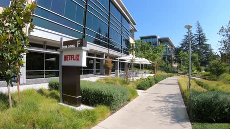 blockbuster : Los Gatos, CA, United States - August 12, 2018: new campus of Netflix HQ made of self-darkening intelligent glass for optimal lighting.Netflix is an entertainment service provider for movies and tv Stock Footage
