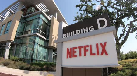 blockbuster : Los Gatos, California, United States - August 12, 2018: Netflix sign at Netflix Headquarters in Silicon Valley, Ca. Netflix is an entertainment service provider for movies and tv. Stock Footage
