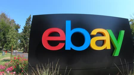 multinational : San Jose, California, USA - August 12, 2018: closeup of eBay sign at eBays headquarters in San Jose, Silicon Valley, California. eBay Inc. is a multinational corporation, a pioneer in e-commerce. Stock Footage