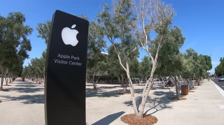 apple headquarter : Cupertino, CA, United States - August 12, 2018: Apple sign of the new Apple store of Apple Park Visitor Center in Tantau Avenue of Cupertino, Silicon Valley, California.