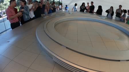 apple headquarter : Cupertino, CA, United States - August 12, 2018: Apple Park Visitor Center with 3d map of new Apple Headquarters and in Tantau Avenue of Cupertino, Silicon Valley, California.