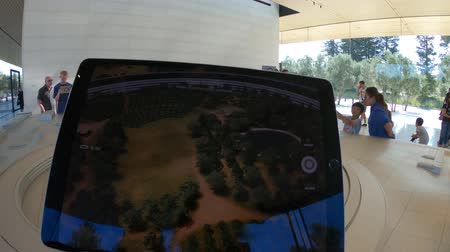 apple headquarter : Cupertino, CA, United States - August 12, 2018: details of iPad with virtual reality program showing the new Apple Offices and the futuristic Campus at the Apple Park Visitor Center in Silicon Valley. Stock Footage
