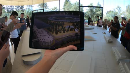 apple headquarter : Cupertino, United States - August 12, 2018: 3d map demonstration with iPad view of the new Apple HQ at Apple Park Visitor Center in Tantau Avenue of Cupertino, Silicon Valley,California.
